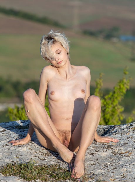 Slender Blonde Julia Crawls Across Moss And Mud While Tota 1